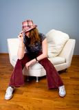 Fashion Girl sit on sofa Royalty Free Stock Photo