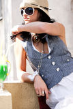 Fashion girl sitting outside Stock Images