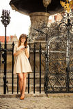 Fashion girl with smart phone outdoors Royalty Free Stock Images