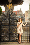Fashion girl with smart phone outdoors Stock Photo