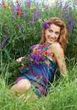 Fashion girl smiling in spring flowers Royalty Free Stock Image