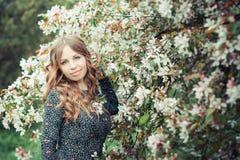 Fashion girl in a spring garden Stock Photo