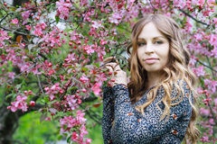 Fashion girl in a spring garden Stock Images