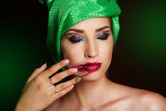 Fashion girl stained lipstick by hand on her face Royalty Free Stock Images
