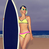 Fashion girl standing on the beach with stylish black surf board.  Stock Photos