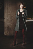 Fashion girl standing under a bridge Royalty Free Stock Photo