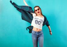 Fashion girl in studio near white background smiling emotionally. Sunglasses. Vogue Style Stock Images