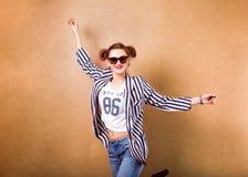 Fashion girl in studio near white background smiling emotionally. Sunglasses. Vogue Style Royalty Free Stock Photo