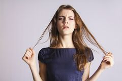 Fashion girl suffers from damaged split ends Royalty Free Stock Photography