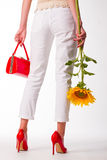 Fashion girl with a sunflower. Stock Photography