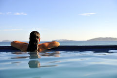 Fashion girl in a swimming pool Stock Photos