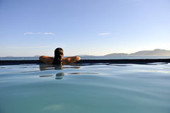 Fashion girl in a swimming pool Royalty Free Stock Images