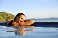 Fashion girl in a swimming pool Stock Photo