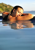 Fashion girl in a swimming pool Royalty Free Stock Photos