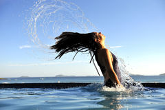 Fashion girl in a swimming pool Stock Photography