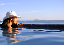 Fashion girl in a swimming pool Stock Images