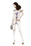 Glamor. Graceful Svelte Slim Woman in Trendy Dress and Handbag. Spring Time. Fashion Girl in Trendy Dress and Handbag. Spring Time royalty free stock images