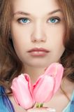 Fashion girl with tulips portrait Royalty Free Stock Photos