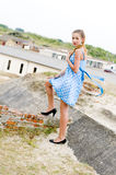 Fashion girl urbex location blue polka dress Royalty Free Stock Photography