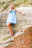 Fashion girl urbex location blue polka dress Stock Images