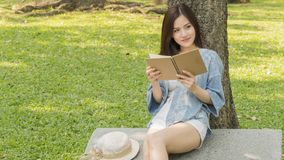 Fashion girl use a book and read in garden park stock photography