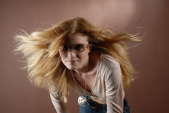 Fashion girl VII. Beautyful fashion girl with sun glasses and waving long red blonde hair royalty free stock photo