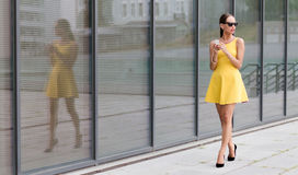 Fashion girl walking in the city Royalty Free Stock Image