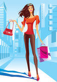 Fashion girl is walking on a street Royalty Free Stock Image