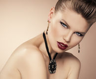 Fashion girl wearing jewelery. Party stiling glamour woman with beautiful jewelery. Close-up of young attractive female model with professional make-up and stock photography