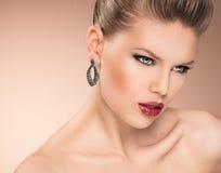 Fashion girl wearing jewelery Royalty Free Stock Images