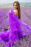 Fashion girl is wearing purple dress Royalty Free Stock Images