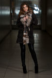 Fashion Girl Wearing Snow Jacket In Shopping Mall Royalty Free Stock Photography