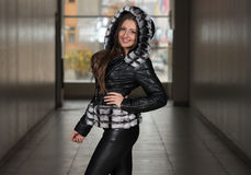 Fashion Girl Wearing Snow Jacket In Shopping Mall Royalty Free Stock Images