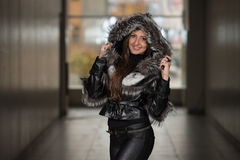 Fashion Girl Wearing Snow Jacket In Shopping Mall Royalty Free Stock Photo