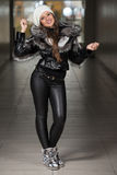 Fashion Girl Wearing Snow Jacket In Shopping Mall Stock Image