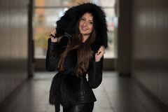 Fashion Girl Wearing Snow Jacket In Shopping Mall Royalty Free Stock Photos