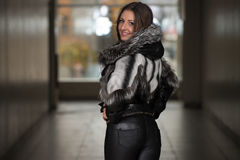 Fashion Girl Wearing Snow Jacket In Shopping Mall Stock Images