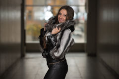 Fashion Girl Wearing Snow Jacket In Shopping Mall Royalty Free Stock Image