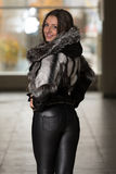 Fashion Girl Wearing Snow Jacket In Shopping Mall Stock Photo