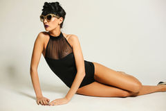 Fashion girl wearing swimming suit in the studio Stock Photo