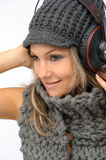 Fashion girl with winter clothes and headphones Royalty Free Stock Photos