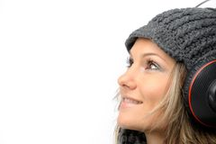 Fashion girl with winter clothes and headphones Royalty Free Stock Photography
