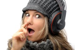 Fashion girl with winter clothes and headphones Stock Image