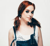 Fashion girl woman hipster portrait. The girl with red hair in denim clothes. stock photo