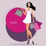 Fashion girl. Woman with shopping bags. Royalty Free Stock Photos