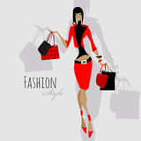 Fashion girl. Woman with shopping bags. Royalty Free Stock Image