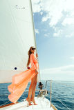 Fashion girl yachting in sea with blue sky sunlight Royalty Free Stock Photos