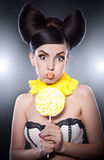 Fashion girl with yellow lollipop and smile agains Stock Image