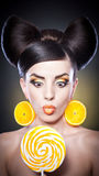 Fashion girl with yellow lollipop and smile agains Stock Photos