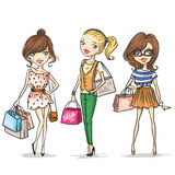 Fashion girls. Three fashion girls with shopping bags Royalty Free Stock Images